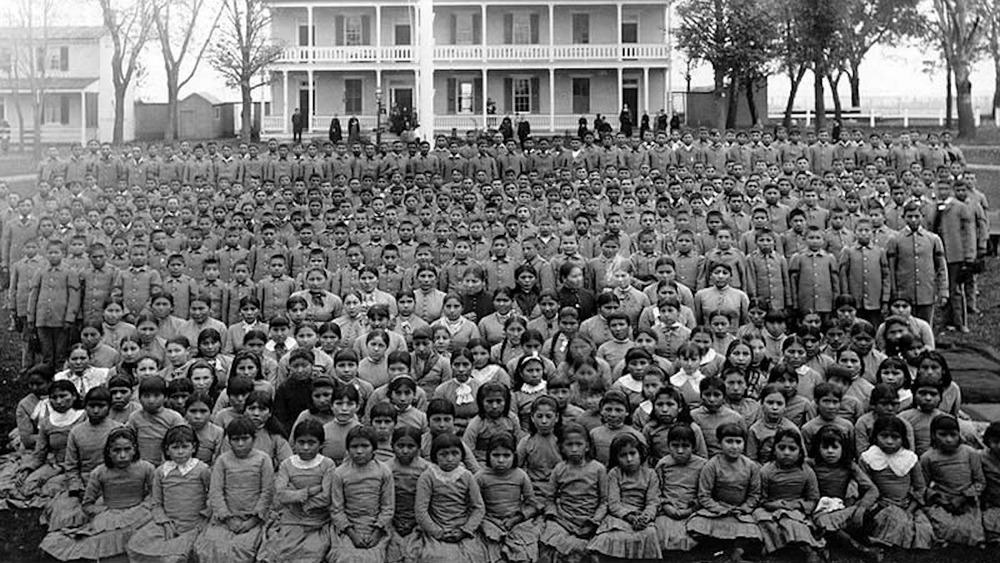 Carlisle Indian School with students out front