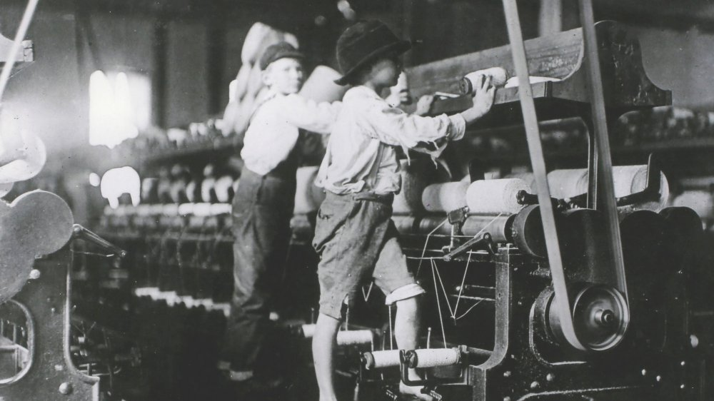 Boys workings textile machine