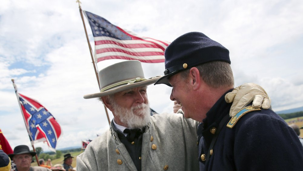 Union and Confederate  soldiers shaking hands