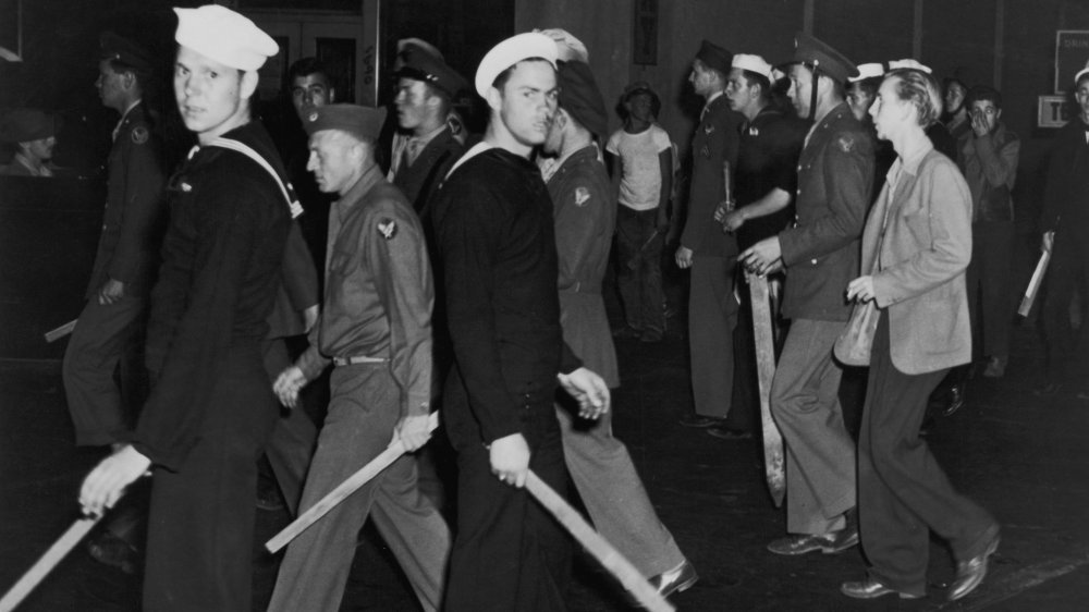 Gangs of American sailors and marines armed with sticks during the Zoot Suit Riots, Los Angeles, California, June 1943.