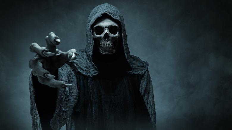 Grim Reaper reaching towards camera