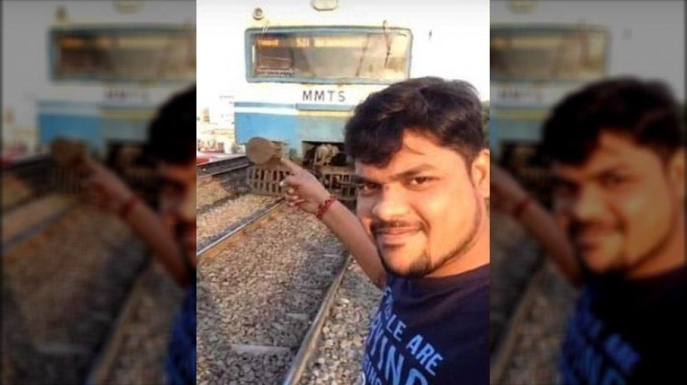 dangerous social media photo, man with train