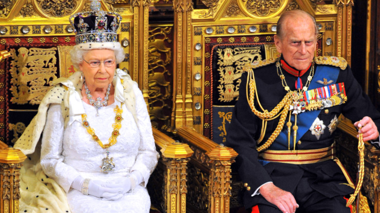 Prince Philip and Queen Elizabeth sitting on throne