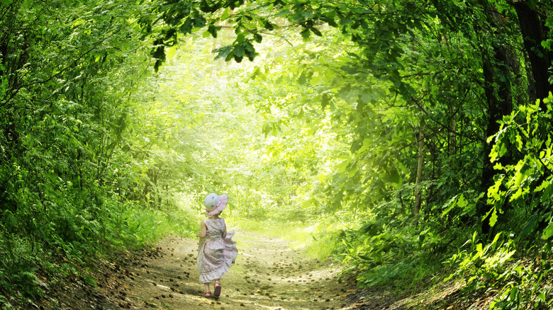 girl walking through a forest