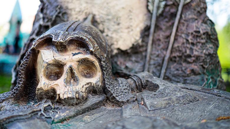 Decorative skull next to an ax