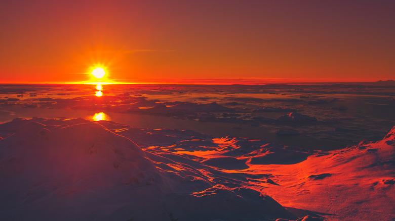 Antarctica under red sun