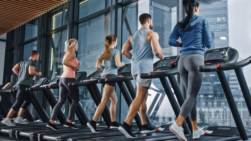 Gym-goers running on treadmills