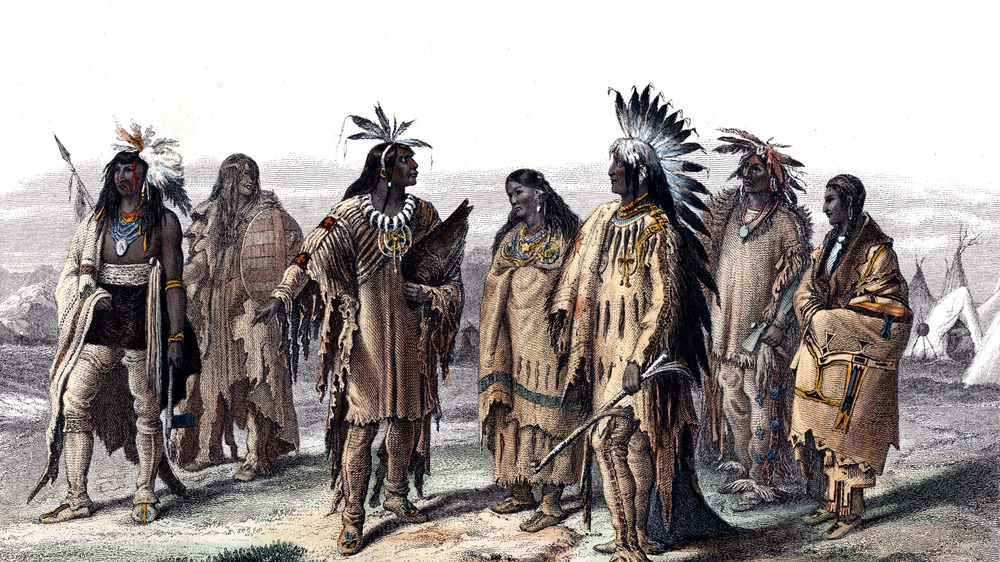 Painting of Native American women in feather headdresses