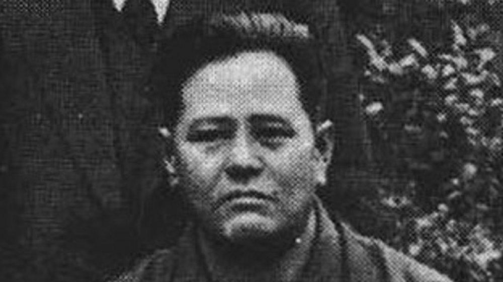 Chojun Miyagi posting for a photo in 1938