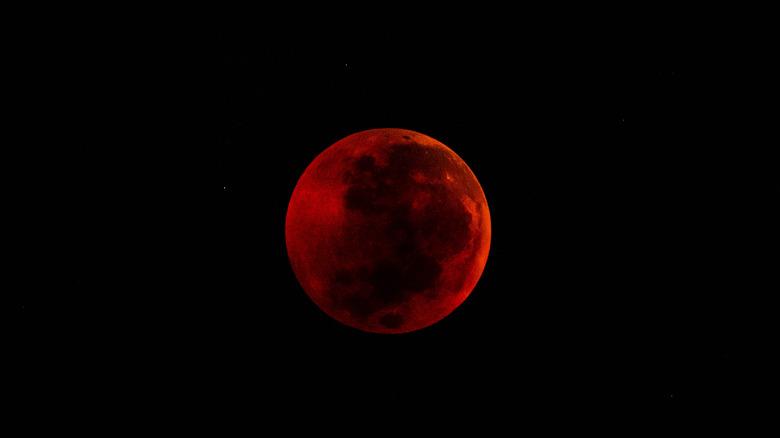 Blood moon in black sky
