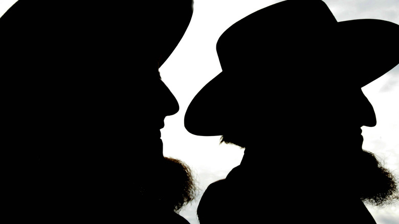 silhouettes of two amish men