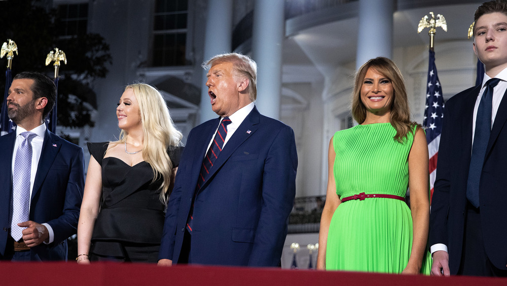 Donald Trump standing with family