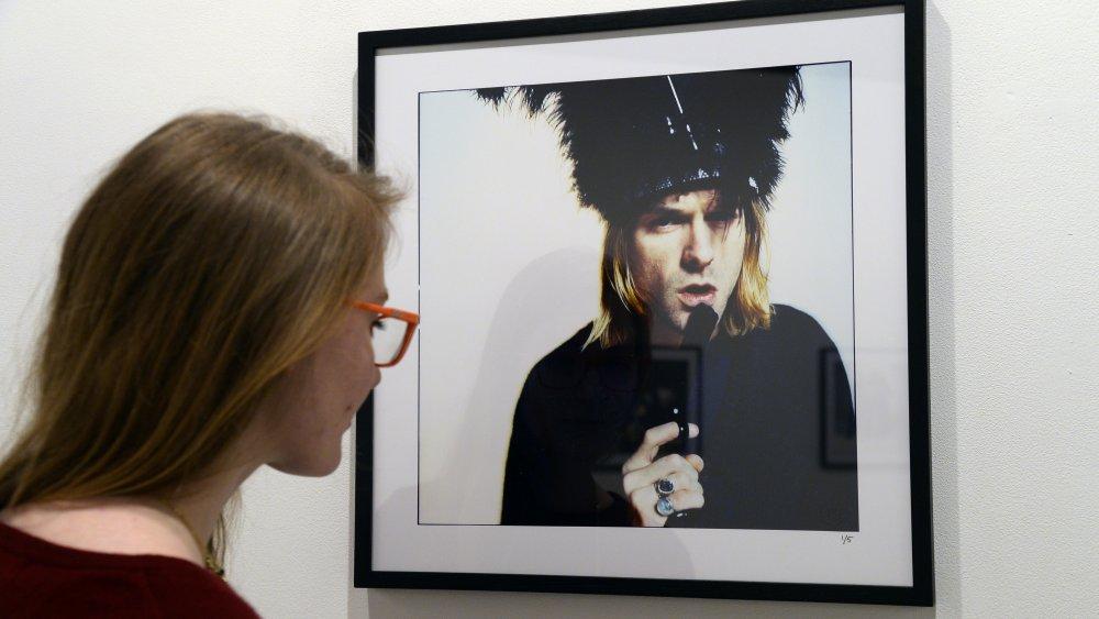 Woman gazes upon photo of Kurt Cobain