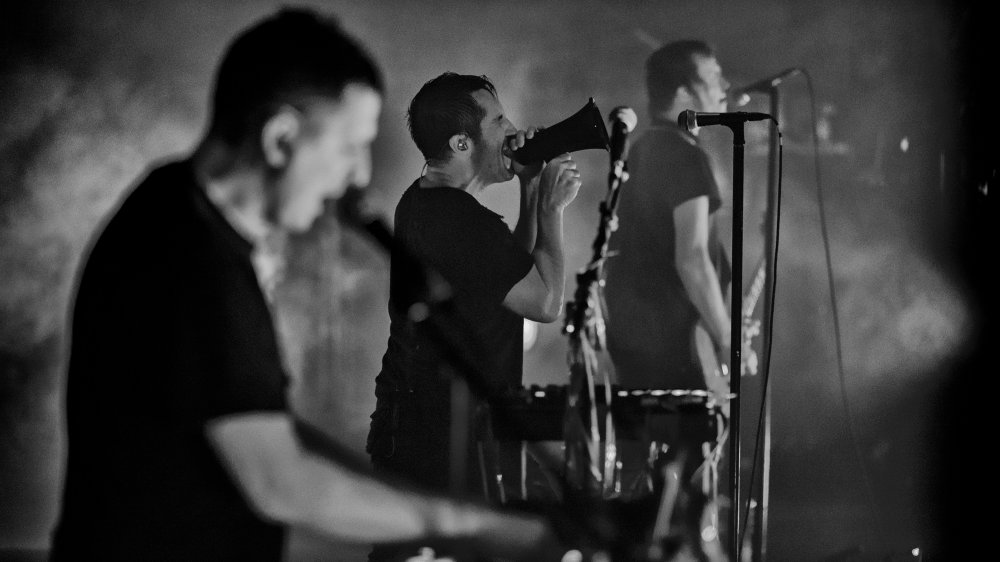 Atticus Ross and Trent Reznor and Robin Finck of Nine Inch Nails