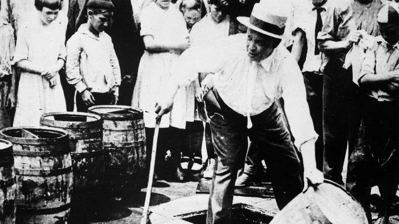 Man destroying beer barrel Prohibition