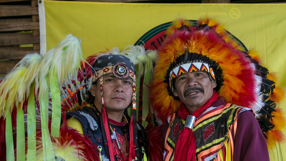 Cherokee dancers pose for the camera along a highway in Cherokee, North Carolina