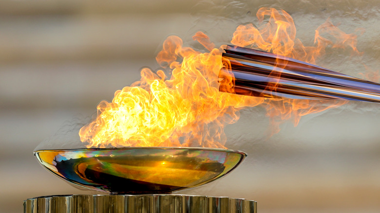 Olympic torch being lit