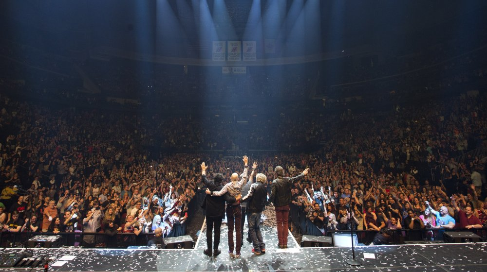 Journey waves to New Jersey crowd.
