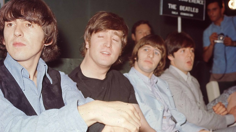 Beatles posing for band photo