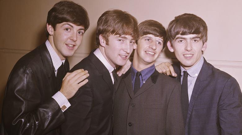 Beatles posing band photo 1964