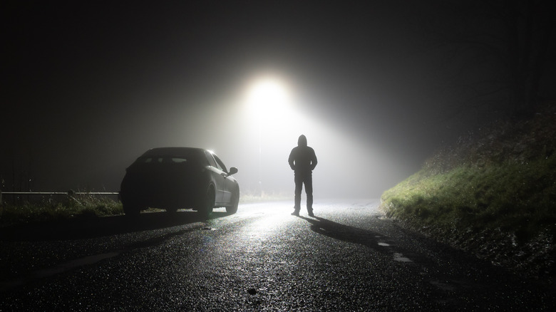 highway with silhouetted man