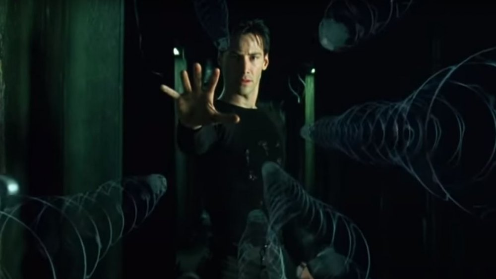 Keanu Reeves as Neo in the 1999's The Matrix