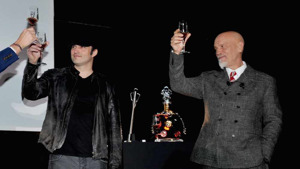 Robert Rodriguez and John Malkovich at a promotional event for Louis XIII Cognac's '100 Years'