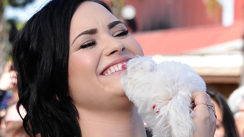 Demi Lovato with their dog, Buddy