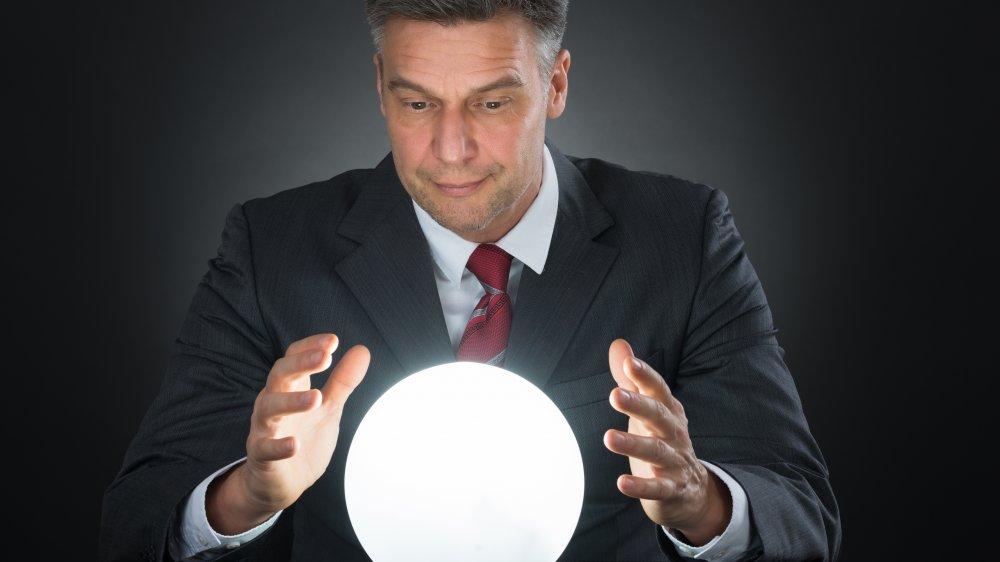Man, crystal ball, predictions
