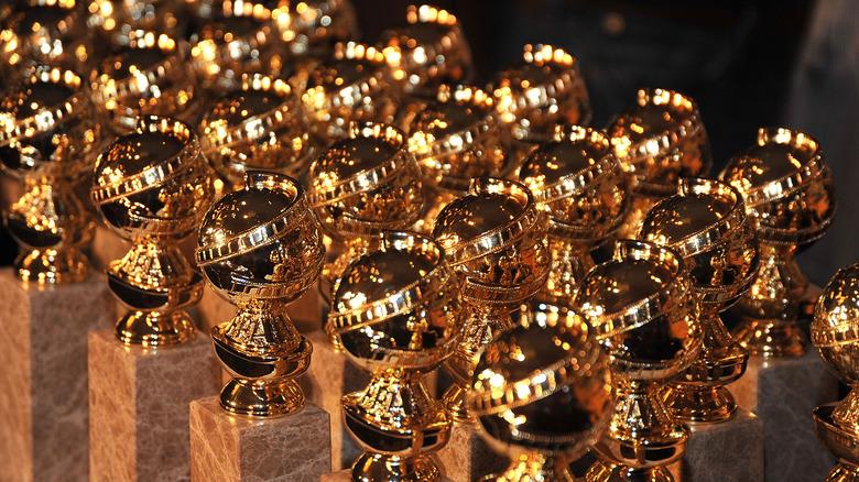 Golden Globe statues in a line