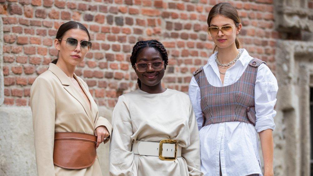 A photograph of three Italian women displaying 21st-century fashion