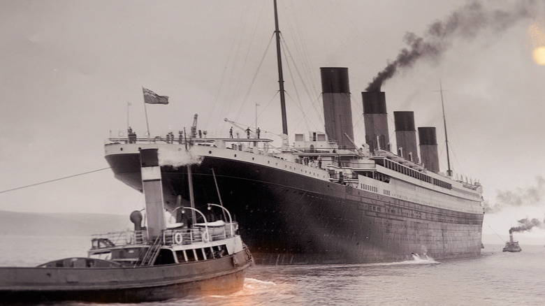RMS Titanic with smaller boat