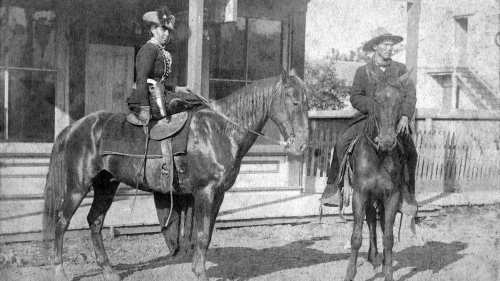 Belle Starr, sitting side saddle on her horse, 1886
