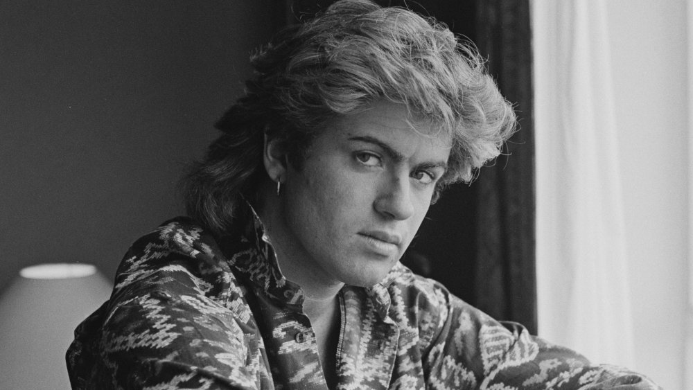 A profile shot of a young George Michael