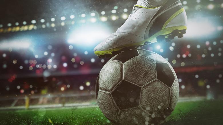 soccer striker kicking ball