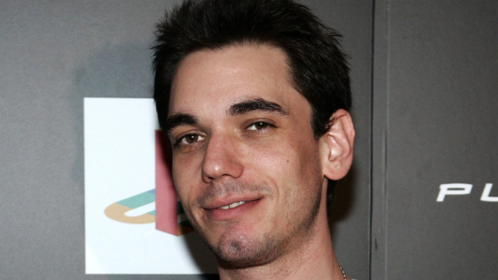 DJ AM poses at an event.