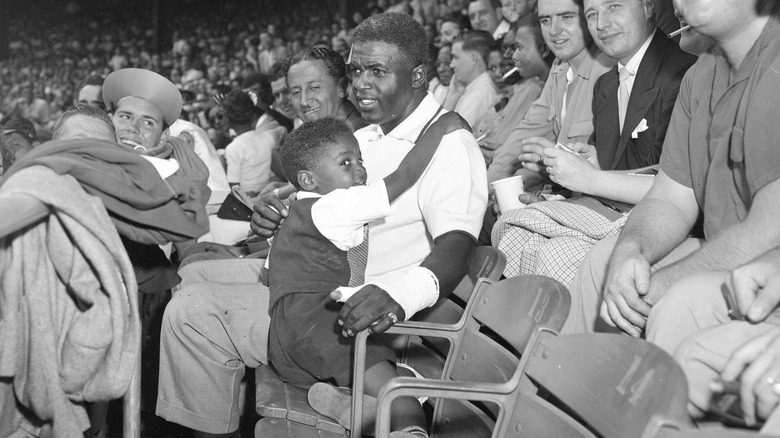 Jackie Robinson healing hand, with his son in the stands
