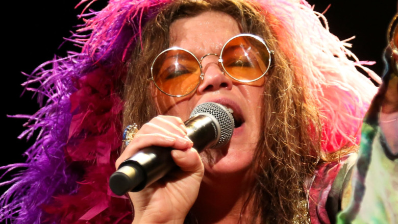 Janis Joplin singing on stage
