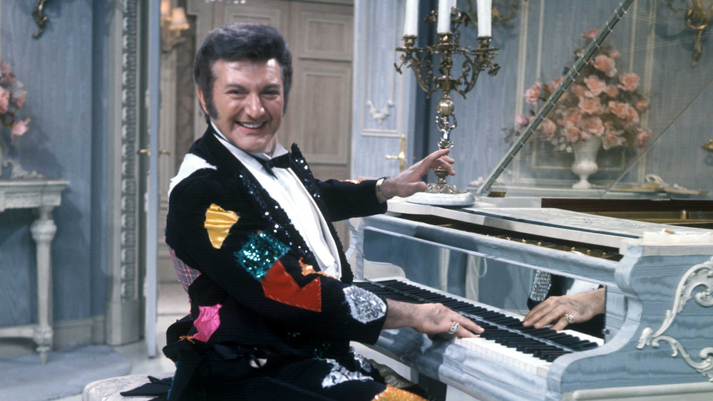 Liberace at the piano