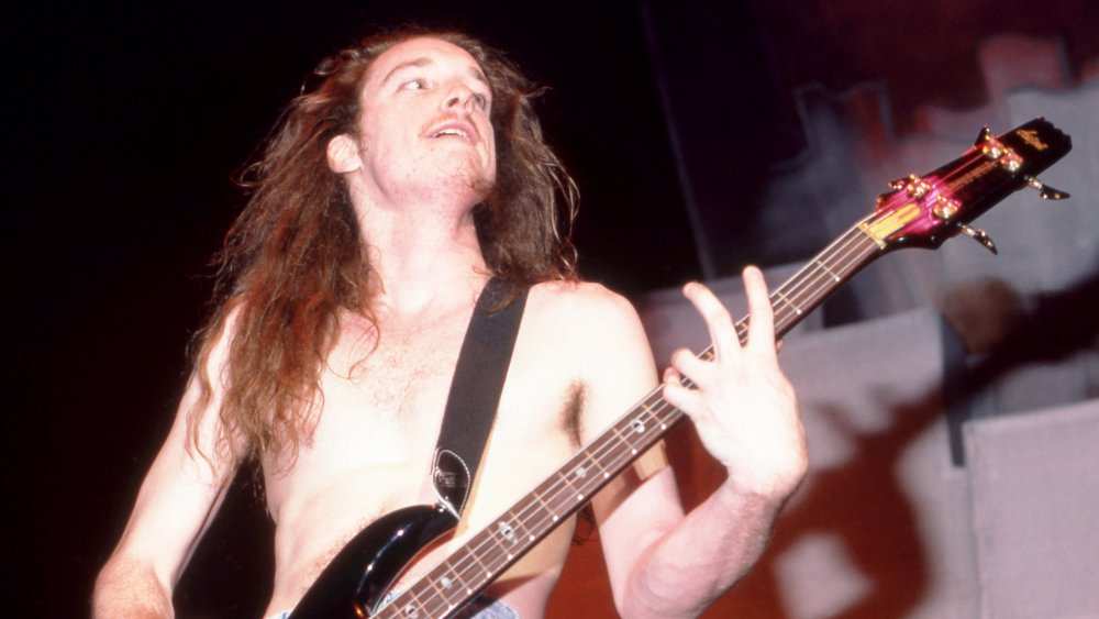 Metallica bassist Cluff Burton jams on the bass during a show