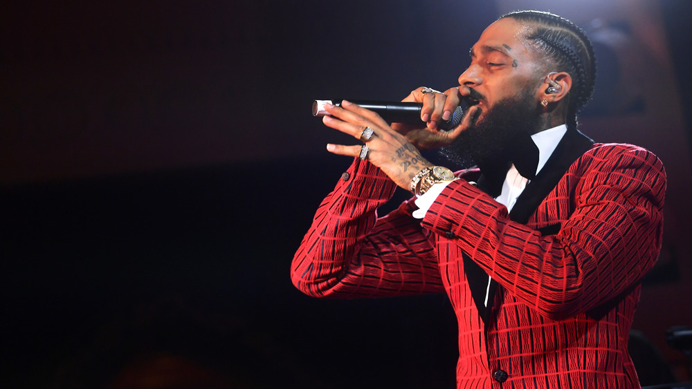 Nipsey Hussle performs on stage