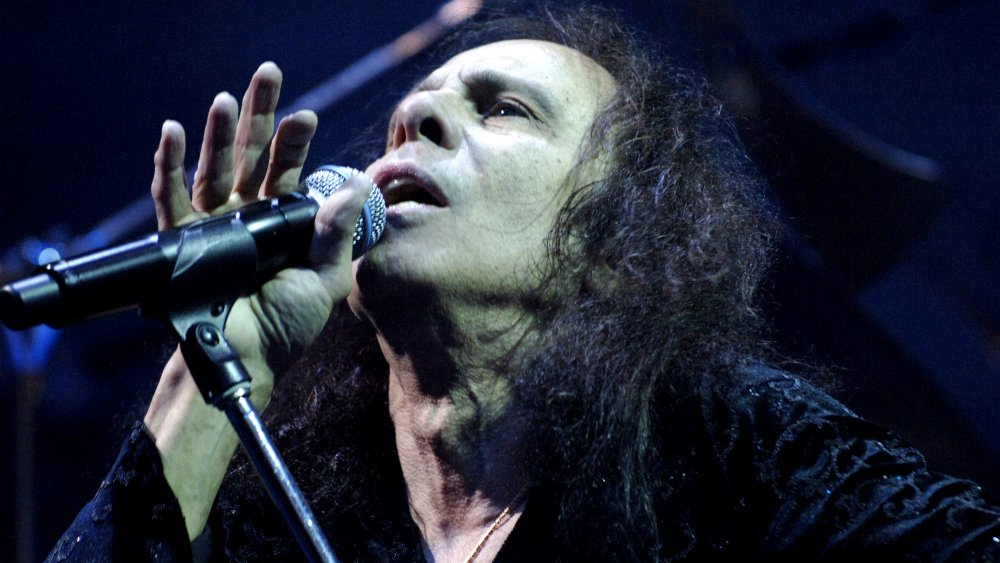 Ronnie James Dio performs in front of a crowd.
