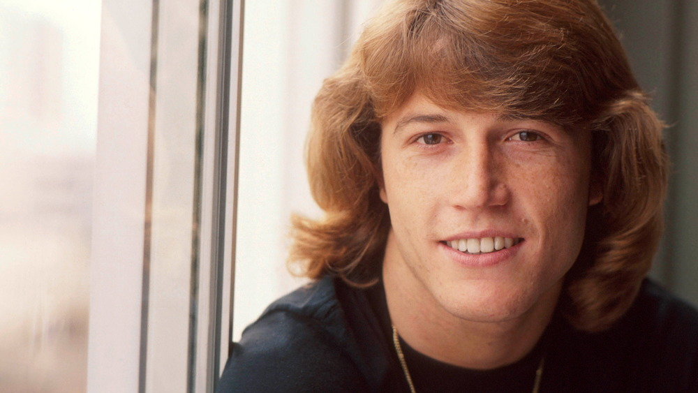 Red hair Andy Gibb smiling