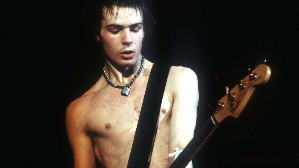 Sid Vicious playing guitar