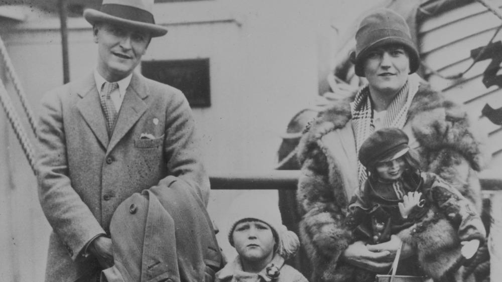 F. Scott and Zelda Fitzgerald, standing with daughter Scottie