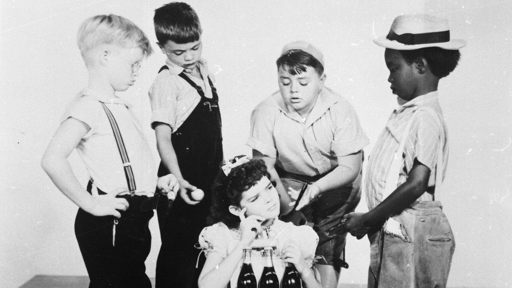 """Billy Laughlin, Robert Blake, George McFarland, Billie Thomas and Darla Hood (seated) pose for a promotional portrait for the film series, """"Our Gang,"""" or also known as """"Little Rascals,"""" in 1940."""