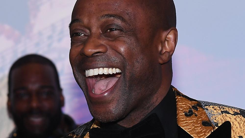 Kem laughs onstage in 2019
