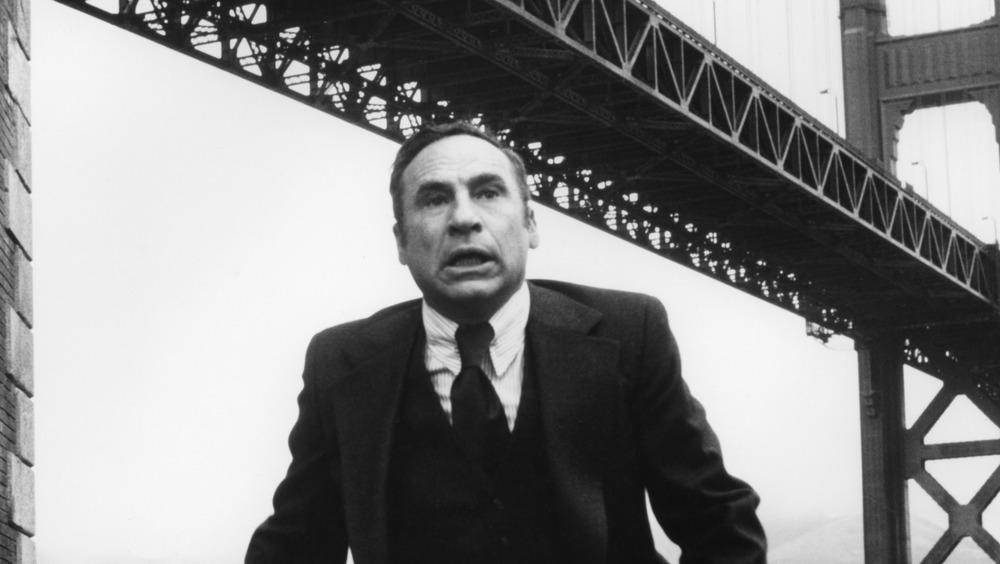 Mel Brooks below a bridge