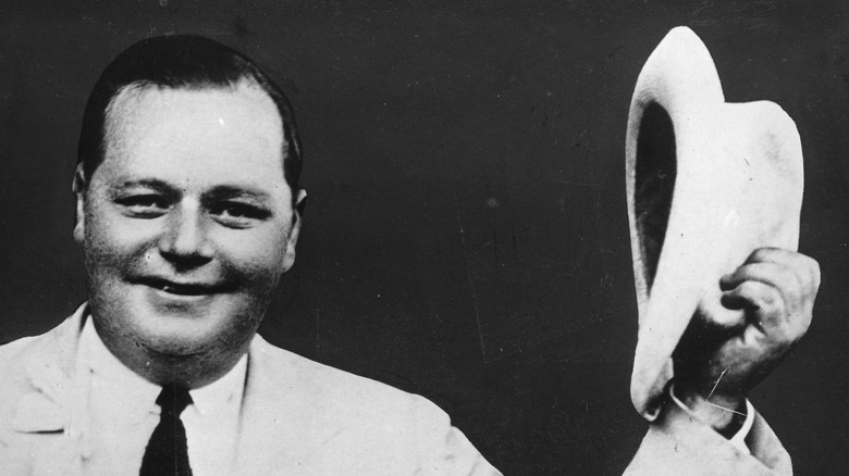 """Roscoe """"Fatty"""" Arbuckle smiling with hat"""