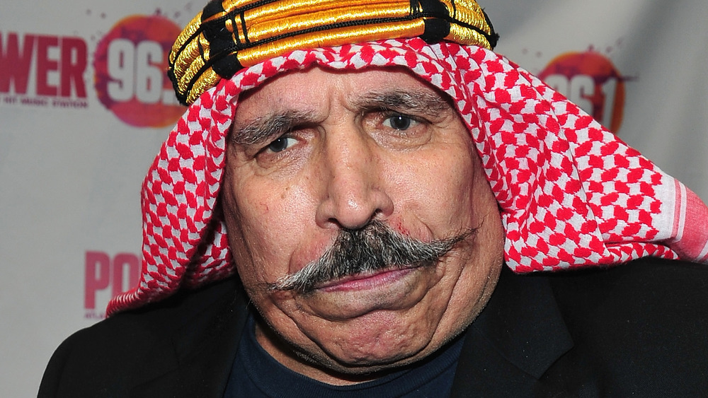 The Iron Sheik in a suit